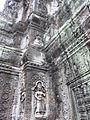 Angkor - Ta Prohm - 024 Tower and Apsaras (8580857653).jpg