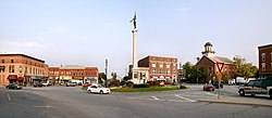 Downtown Angola's traffic circle (or roundabout), looking east.  The monument in the center is dedicated to those who served in the American Civil War.  The building with the cupola is the Steuben County courthouse, which is on the National Register of Historic Places.