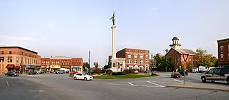 "Angola, Indiana - Downtown Angola's traffic circle (or roundabout-- nicknamed ""The Mound""), looking east.  The monument in the center is dedicated to those who served in the American Civil War.  The building with the cupola is the Steuben County courthouse, which is on the National Register of Historic Places."