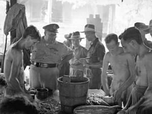 George Wootten - Major General Wootten (second left) with Australian ex-POWs at Batu Lintang POW/internment camp, Kuching, Sarawak, 12 September 1945.