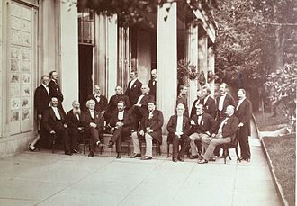 Aztec Club of 1847 - Photograph featuring members of the Aztec Club with guests, was taken at the mansion of Gen. Robert Patterson in Philadelphia during an anniversary dinner of the club on September 16, 1873. Seen in the photograph are former officers of both the Union and Confederate Armies, from left to right: (sitting on the front row) Gen. Fitz John Porter, Capt. Henry Coppee, Gen. Robert Patterson, President Ulysses S. Grant, Gen. George A.H. Blake, Gen. John G. Barnard (misidentified as I.G. Barnard), Gen. Oliver L. Shepherd, and Gen. William H. French; (second row) Governor Milledge L. Bonham, Gen. John J. Abercrombie, Surgeon John M. Cuyler, Gen. T.L. Alexander, Lt. Col. Frederick D. Grant (as a guest of the dinner), Gen. Orville E. Babcock, Capt. E.L.F. Hardcastle, Gen. William F. Barry, and Gen. Cadmus M. Wilcox; (last row) Col. Charles I. Biddle, Gen. Zealous B. Tower, and Gen. Robert E. Patterson.