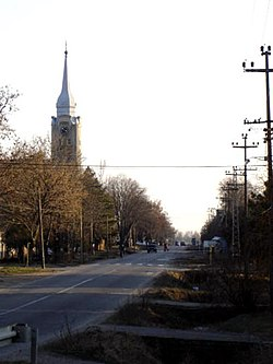 Main street with Catholic church in Bačko Gradište