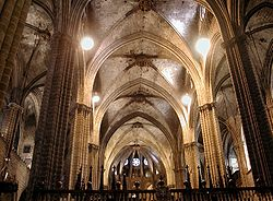Barcelona Cathedral has a wide nave with the clerestorey windows nestled under the vault.