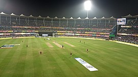 Barsapara Cricket Stadium match under floodlights.jpg