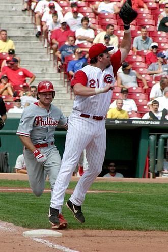 First baseman - Sean Casey, former first baseman for the Cincinnati Reds tries unsuccessfully to keep his foot on the base while receiving a throw from an infielder.