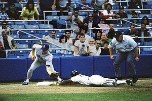 Larry Barnett - Larry Barnett, upper right, waits to make a call on a stolen base attempt by Rickey Henderson in 1988.