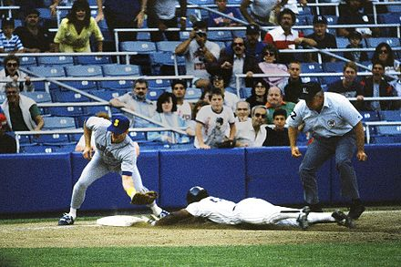 Rickey Henderson--the major leagues' all-time leader in runs and stolen bases--stealing third base in a 1988 game Baseball steal.jpg