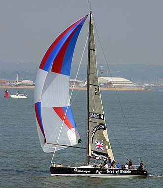 Spinnaker - Bear of Britain, a Farr 52 with masthead spinnaker in front of Calshot Spit