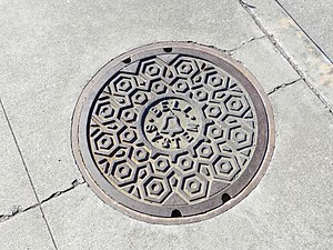 Bell System - Manhole cover with Bell System logo
