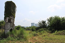 The chimney of the Local Inn, with Bellefonte Nuclear Generating Station in the background