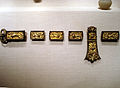 Belt buckle and ornaments, gilt bronze and copper, Sui Dynasty.jpg