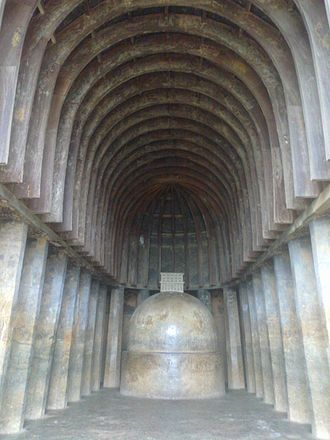Chaitya - An early chaitya at Bhaja Caves; wooden architecture imitated in stone, with decorative roof timbers in wood. 2nd century BCE.