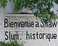Bienvenue a Shaw, Slum Historique.jpg