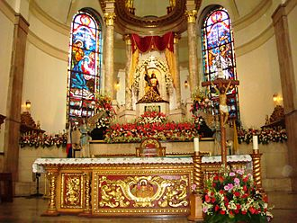Black Nazarene - The image enshrined above the high altar of the Minor Basilica of the Black Nazarene, Manila.