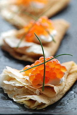 Blini with sour cream and red caviar