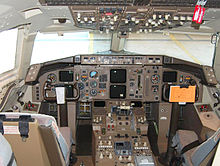 View of a 757 cockpit with six paired color displays.