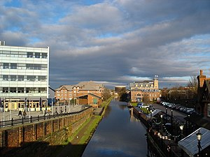 Sale, Greater Manchester - View of the Bridgewater Canal, looking north towards Stretford. The railway runs parallel with the canal.