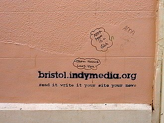 "Independent Media Center - Graffito in Bristol, United Kingdom advertising the local chapter of Indymedia with the slogan ""Read it, write it, your site, your news"""