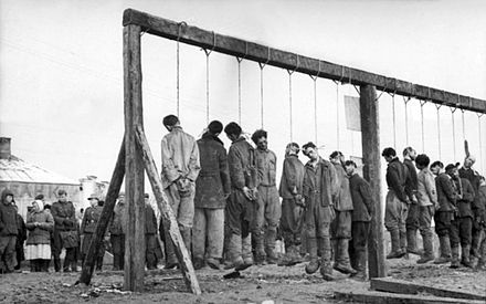Soviet partisans hanged by the German army. The Russian Academy of Sciences reported in 1995 civilian victims in the Soviet Union at German hands totalled 13.7 million dead, twenty percent of the 68 million persons in the occupied Soviet Union. Bundesarchiv Bild 101I-031-2436-03A, Russland, Hinrichtung von Partisanen retouched.jpg
