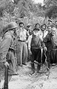Aged civilians confronting the paratroopers at Kondomari.