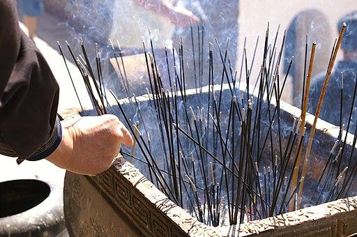 Burning incense sticks at Wutai Shan