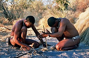 Botswana - Starting fire by hand. San people in Botswana.