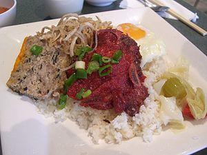 """Broken rice - Cơm tấm (literally """"broken rice"""") with a lemongrass pork chop, from Vietnam."""