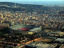 Barcelona stadium seen from above. It is a large and asymmetrically shaped dome.