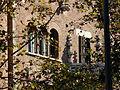 Casa de les Punxes - entre els arbres.jpg