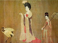 One plump woman wears a flower and chases a bird while another stands holding an umbrella.