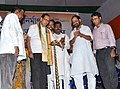 Chowdhury Mohan Jatua lighting the lamp to inaugurate the Bharat Nirman Public Information Campaign, at Kakdwip block of South 24 Parganas, West Bengal on March 10, 2012.jpg