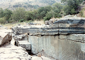 Bushveld Igneous Complex - Chromitite (black) and anorthosite (light grey) layered igneous rocks in Critical Zone UG1 of the Bushveld Igneous Complex at the Mononono River outcrop, near Steelpoort