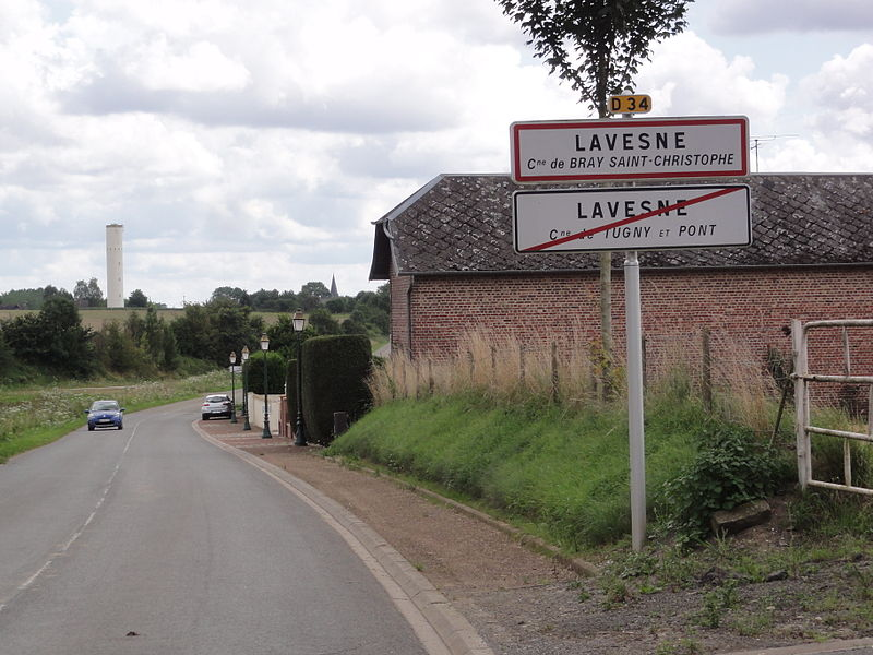 City limit sign Lavesne (2 municipalities),  and water tower of Tugny-et-Pont