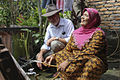 Clean water to the house makes life much easier. Indonesia, 2012. Photo- AusAID (10686853323).jpg