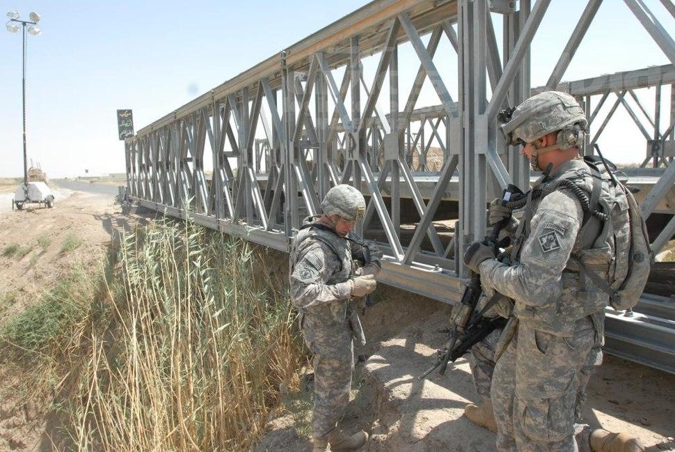 Combat engineers inspect a bridge on Route Arnhem in Iraq