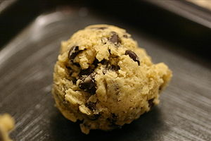 A ball of chocolate chip cookie dough ready fo...