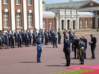 Royal Air Force College Cranwell - Omani officer cadet saluting British Prime Minister David Cameron.