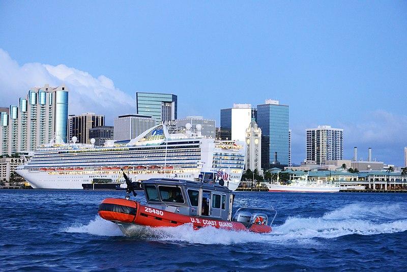 U.S. Coast Guard escorts a cruise out of Honolulu Harbor