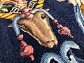Détail de l'endroit d'un tapis de Savonnerie (tête d'animal).jpg