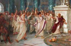 Kahverengi ve kırmızılı adam beyazlı adamlar tarafından bıçaklanıyor
