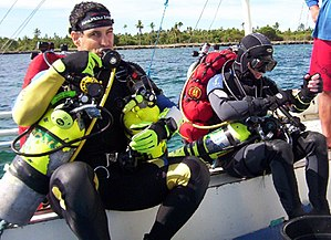 Nitrox - Technical divers preparing for a mixed-gas decompression dive in Bohol, Philippines. Note the backplate and wing setup with side mounted stage tanks containing EAN50 (left side) and pure oxygen (right side).