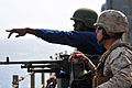 Defense.gov News Photo 100923-N-7948R-034 - U.S. Navy Yeoman Seaman Corey Gathings points to a suspected pirated vessel in the Gulf of Aden while standing as starboard watch aboard the.jpg