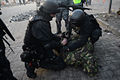 Detention of a protester by interior troops officers. Clashes in Kyiv, Ukraine. Events of February 18, 2014.jpg