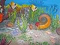 Diorama of a Pennsylanian seafloor - Amphicentrum fish, Tainoceras nautiloid, Aviculopecten scallops, Trigonotreta brachiopods, algae (45541427302).jpg