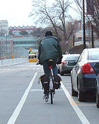 Cyclist riding in a bike lane situated in a door zone