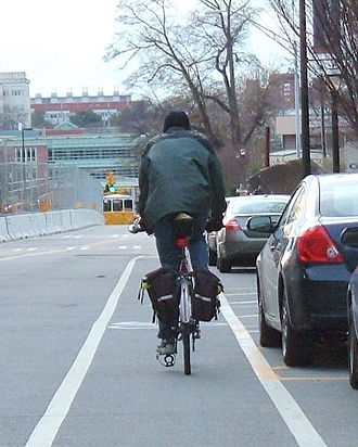 Dooring - Cyclist riding in a bike lane situated in a door zone
