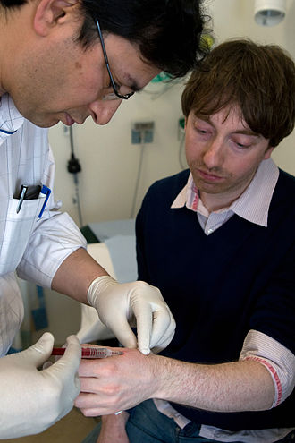 Microchip implant (human) - A surgeon implants British scientist Dr Mark Gasson in his left hand with an RFID microchip (March 16, 2009)