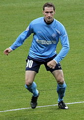 A white footballer in his early twenties, wearing a Krylia Sovetov light blue kit, on a football pitch during a match.