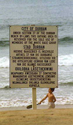 """Petty apartheid"": sign on Durban beach in English, Afrikaans and Zulu (1989)"