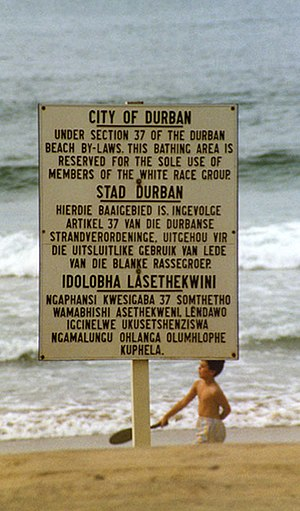 "Reservation of Separate Amenities Act, 1953 - Durban beach sign in English, Afrikaans and Zulu, declaring the beach ""Whites Only"""